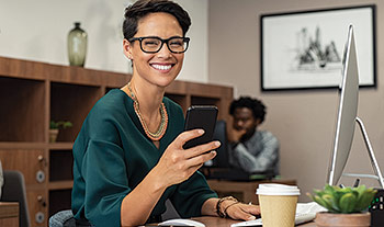 Photo of woman wearing glasses that correct refractive errors