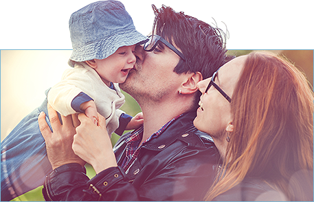 Photo of Smiling, Happy couple with baby wearing quality eyewear