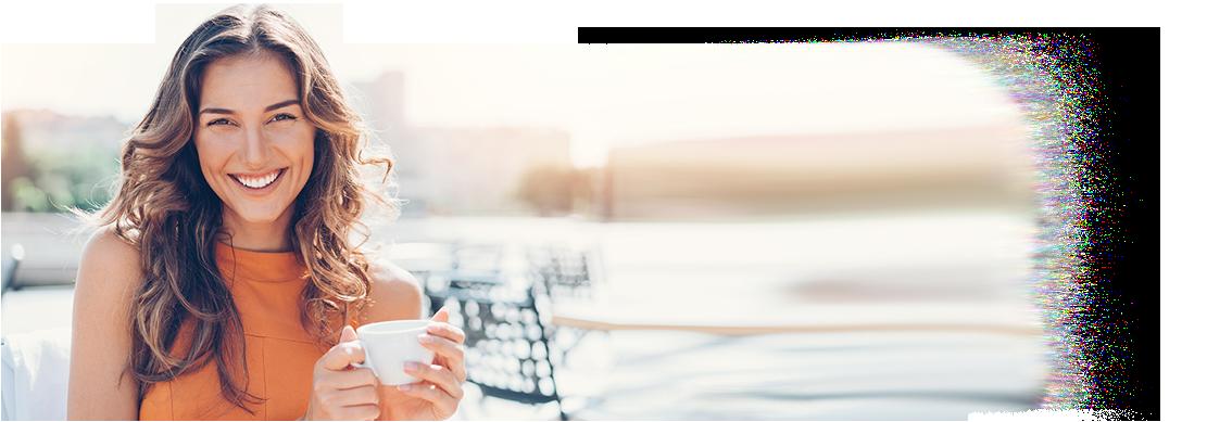 Happy contacts-wearing woman enjoying coffee